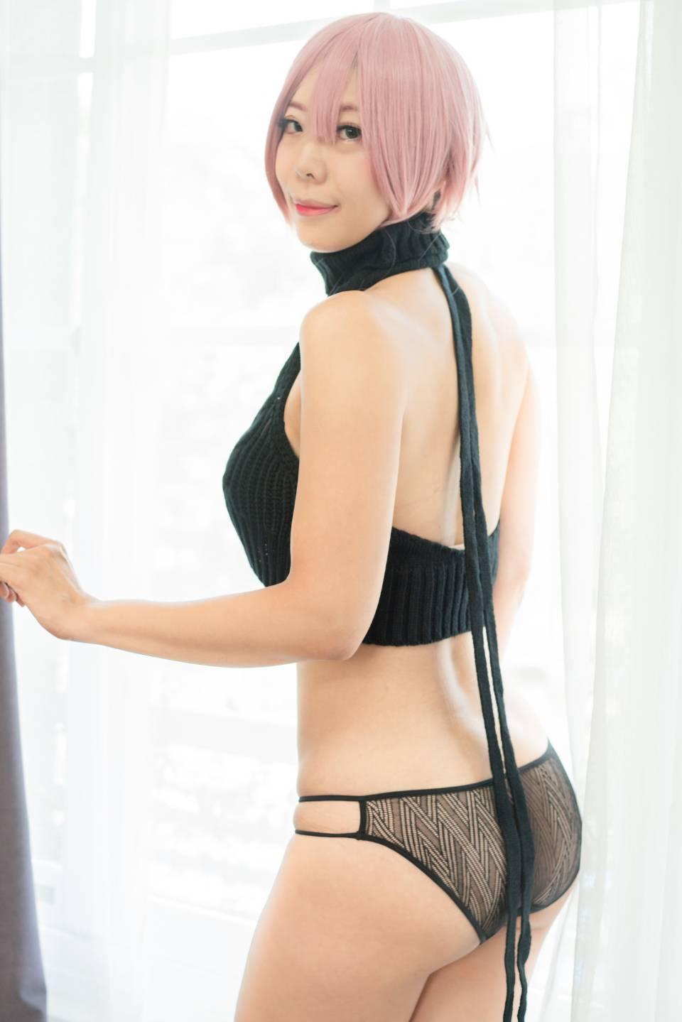 A young and sexy asian woman weared black bikini
