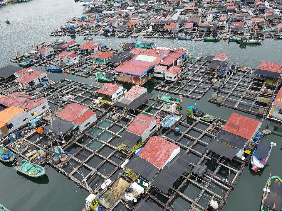 A fishing village of fishermans on the sea water in island Hainan