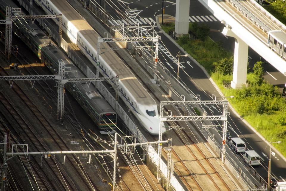 Shinkansen trains depart from rail station in Japan