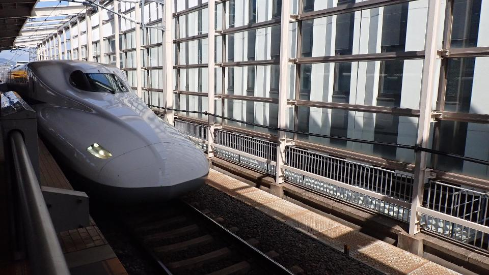 Shinkansen trains depart from rail station in Japan
