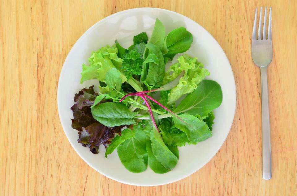 Fresh baby greens in a salad