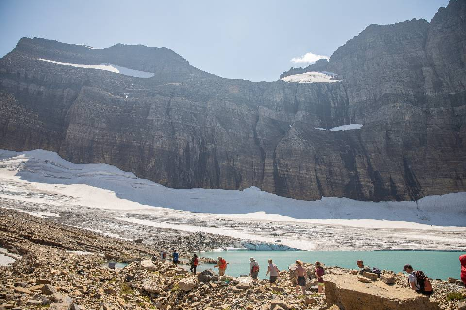 People hike toward Grinnell Glacier