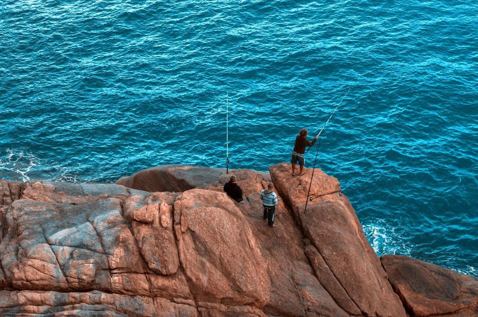 Fishing from the rocks on the seashore