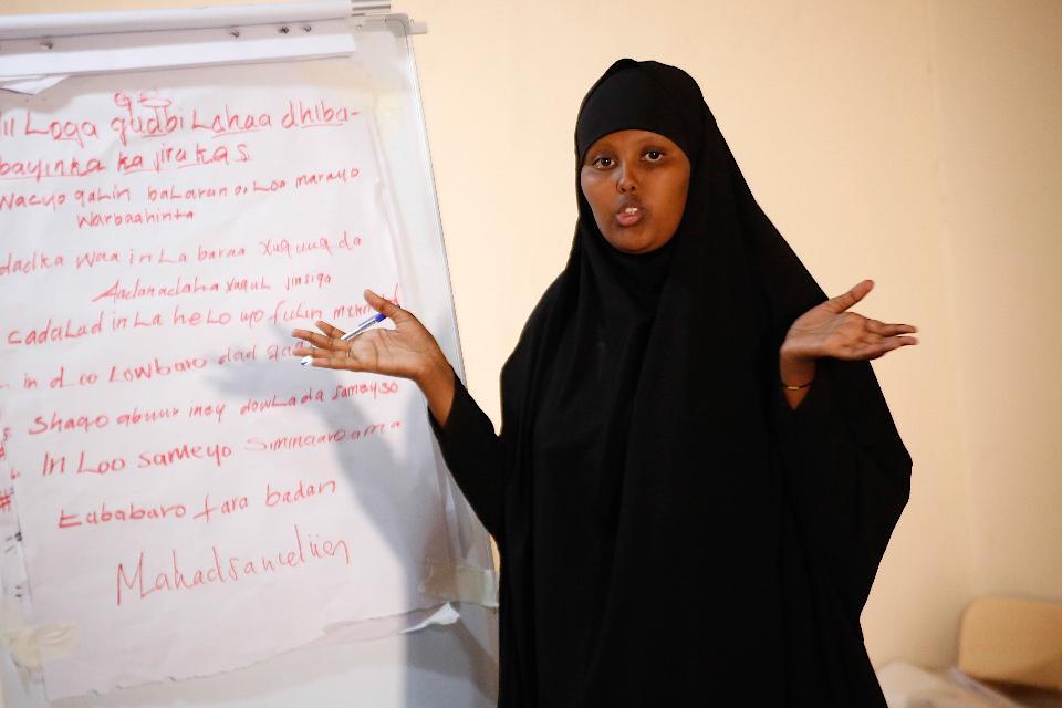 A female participant makes a presentation during a workshop