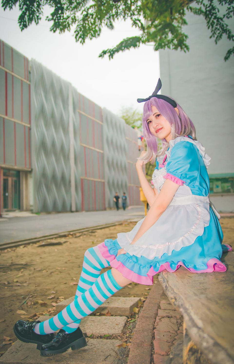 cosplayers dress up as Japanese Manga characters