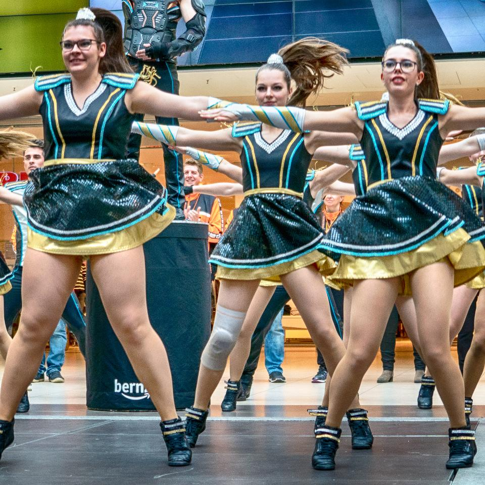 Cheerleader and dancer performing on stage