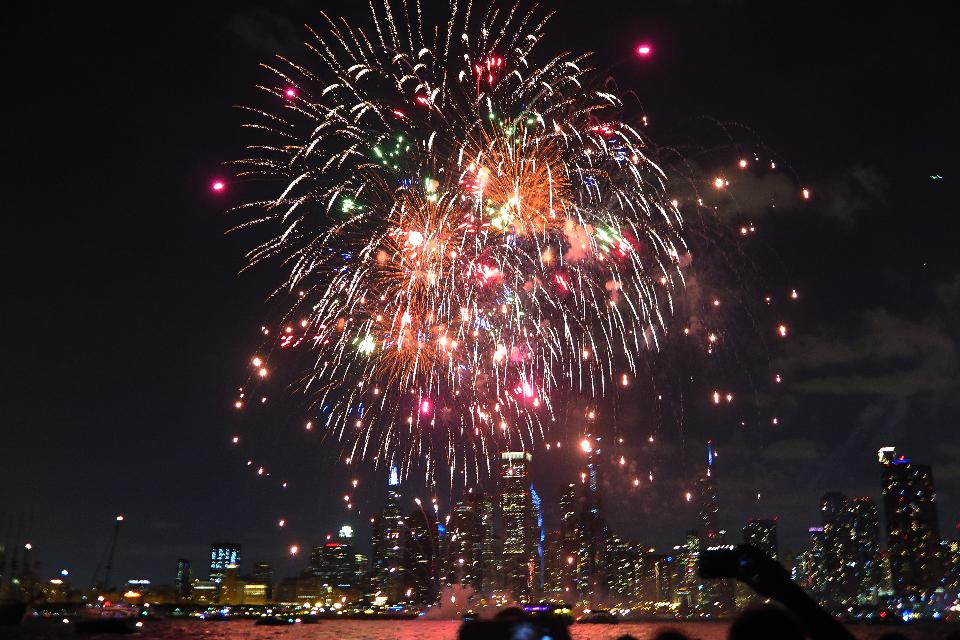 View of Chicago downtown and Navy Pier with grand fireworks
