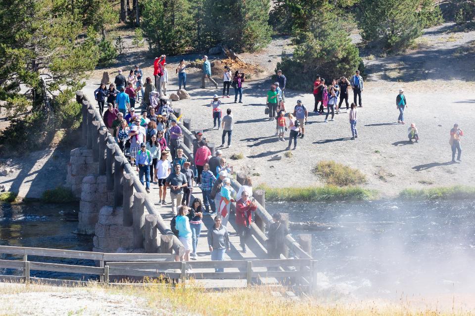 People on the Firehole River bridge