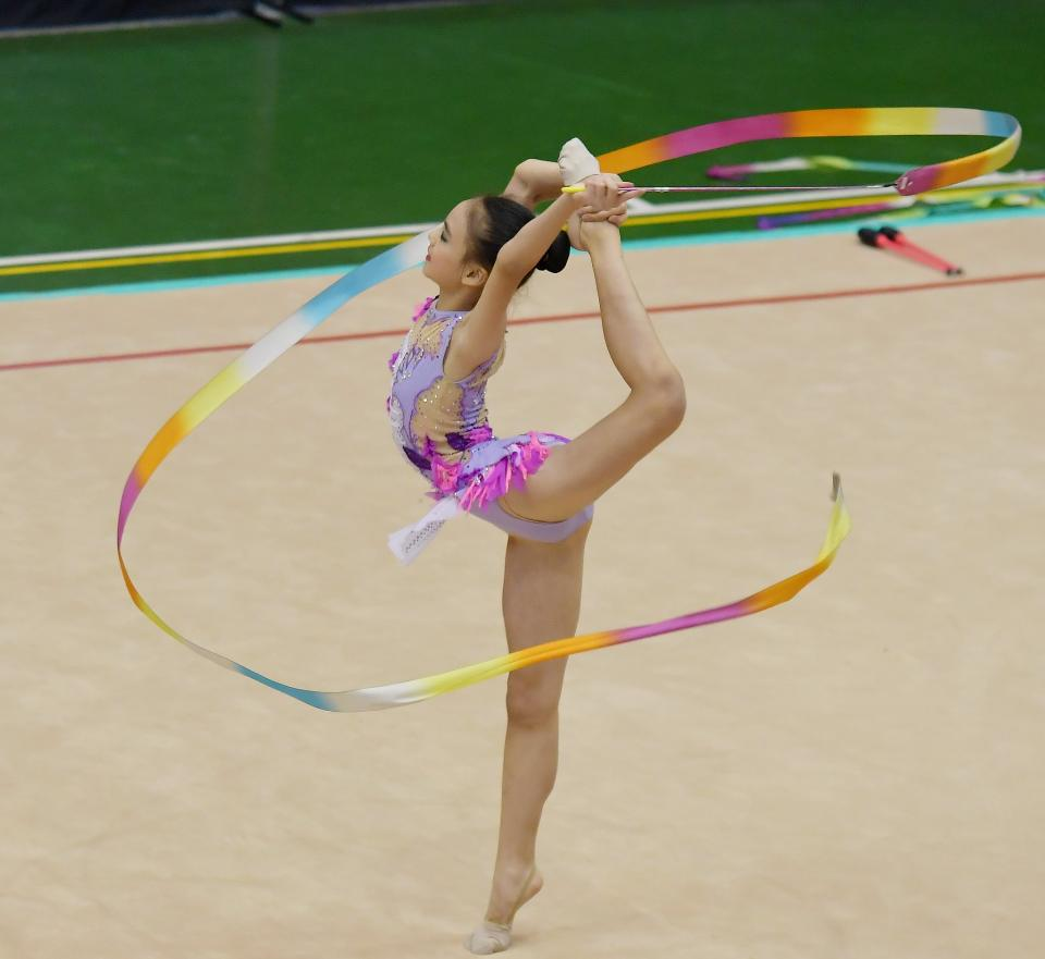 Beautiful rhythmic gymnast in professional arena