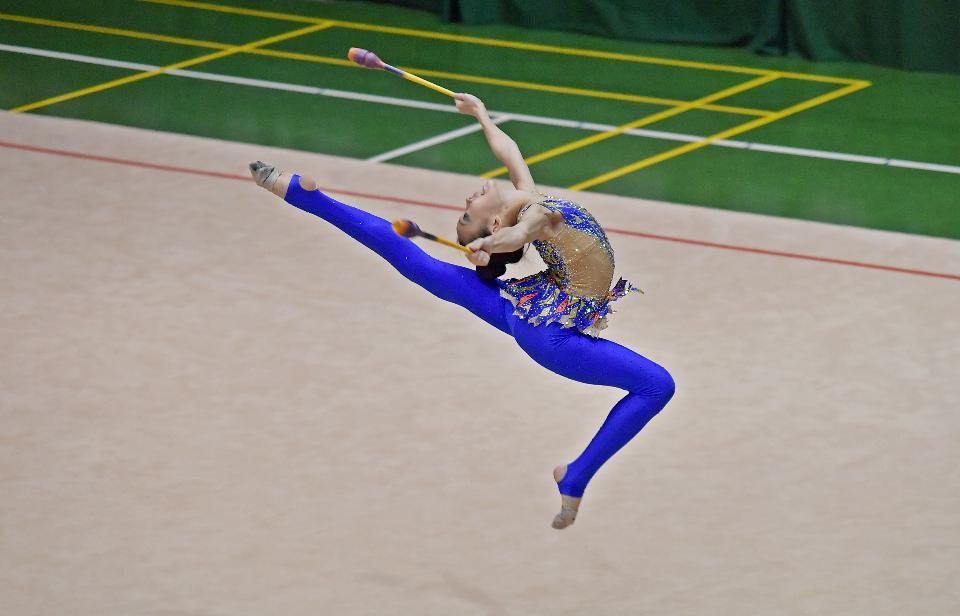Beautiful rhythmic gymnast in professional arena