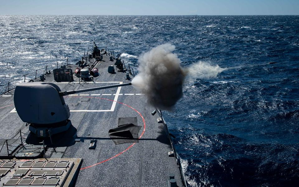 USS Porte fires a Mark 45 5-inch gun
