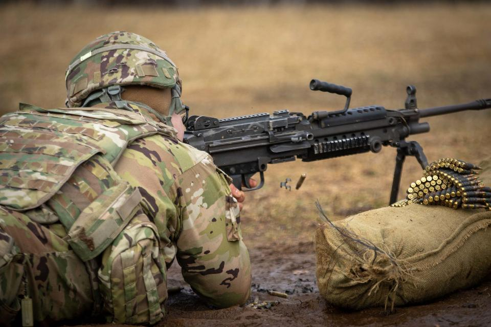 Soldier with a machine gun is training in shooting