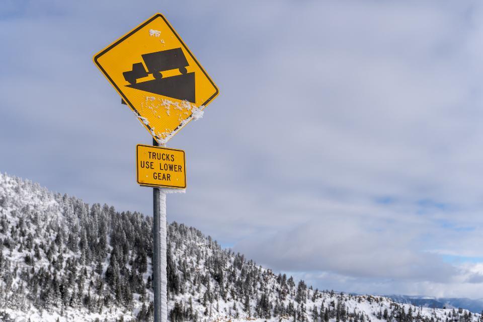 trucks use lower gears sign