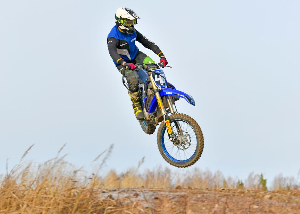 Motocross driver jump in the air