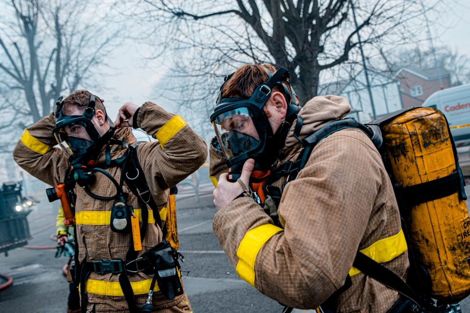 Portrait of two heroic fireman in protective suit