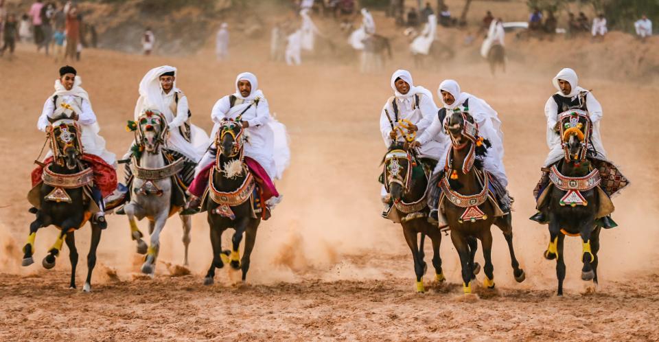 Saudi Arabia Horse rider on traditional desert safari festival