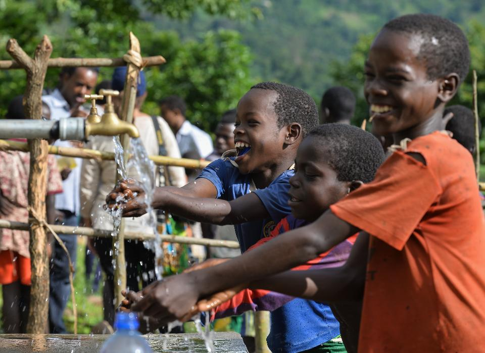 children enjoy water access for the first time