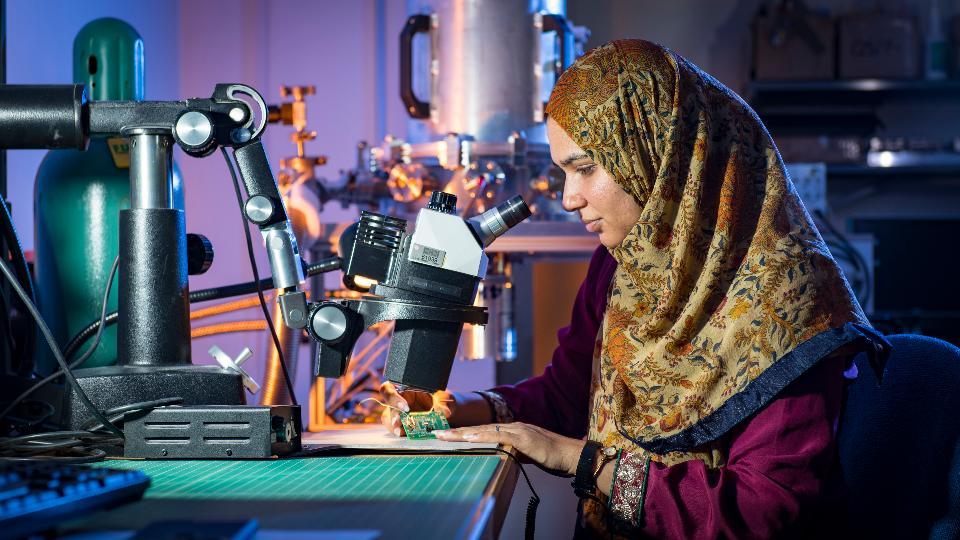 female scientist use microscope in the laboratory