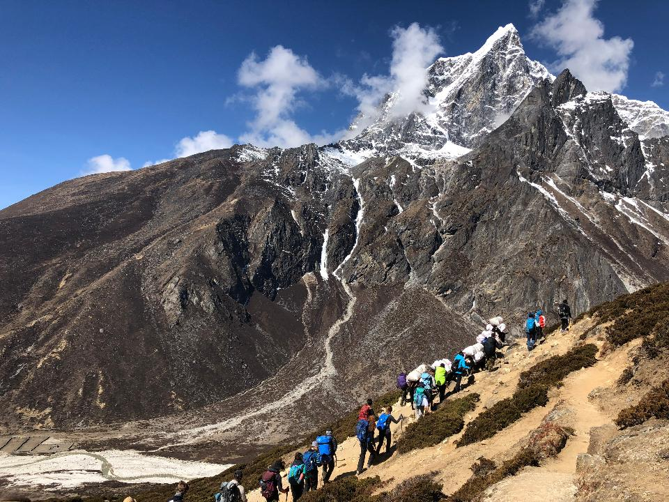 Group of trekkers on the way to Everest Himalaya