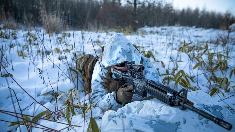 Special forces sniper with large-caliber rifle