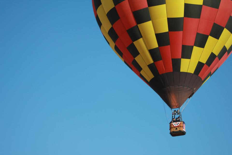 Colorful hot air balloons flying over mountain