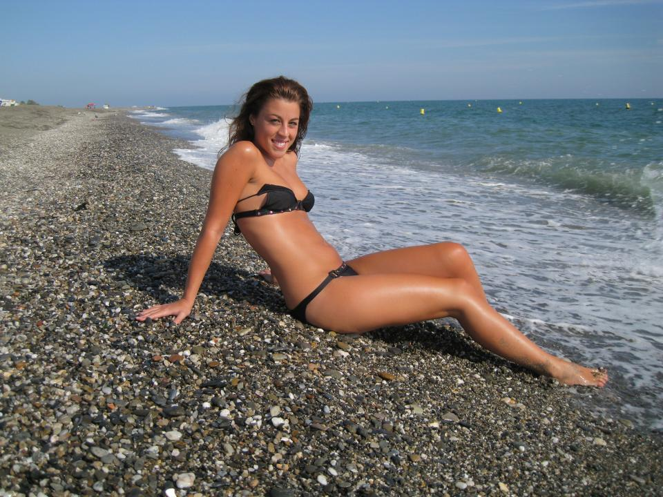 Sexy girl lying on the tropical beach